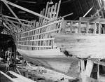 """Partially Planked Hull Of A Boat Under Construction """"Photo By W.H. Ballard"""" by W. H. Ballard"""