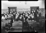 """Group Of School Students In Room With Graffitti On Blackboards And Chairs . """"Perley Cross Interior, High School"""" by George French"""