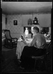 George French Reading By Kerosene Lamp. by George French