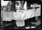 George French's Mother Hanging Out Cloths. by George French