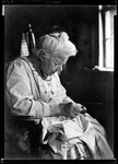 George French's Mother Sewing. by George French