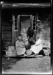 George French And Mother And Wife On Front Steps Of Homestead- He Showing An Antique Jug by George French