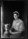 Don French Holding Horseshoe Pitching Trophy by George French