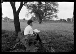 Don F. Reading Book Under Tree by George French