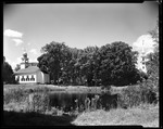 Small Pond Behind Churches, One On Left One On Right In Sandwich, N.H. by George French