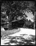 Road Leading To A Covered Bridge, Large Tree Overhangs In Sandwich, New Hampshire by George French