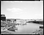 End Of Building And Pier On Left, Stone Wall On Right, Boats All Around In Kittery by George French