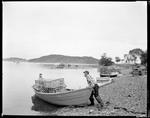 Lobsterman Pushes Boat Off Of Shore, Boats, Traps On Right In Bucks Harbor by George French