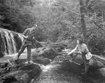 Man & Woman Stream Fishing, She Netting His Catch by George French