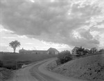 Road Goes Up By Large Farm Buildings In Alna, 1939