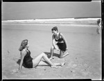 Two Girls Sitting On Beach, Talking, Surf In Background--ogunquit by George French