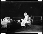 """Ma"", George French's Mother, Reading Amid A Pile Of Books In Attic Of Homestead--Kezar Falls by George French"
