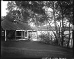 Couple On Porch Of A Camp Overlooking A Lake A Rangeley by French George