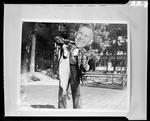 Gag Shot Of Harold Holding A Fish by George W. French