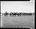 Fifteen Horseback Riders In A Line by George W. French