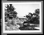 Shot Of Covered Bridge Over Stream by George French