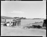 Boat Hauled Out On Shore Near Wharf In Brooklin by George French