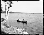 A Couple In A Canoe, Sailboats In Background In Jefferson At Camp Wavus by George French
