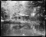 A Scenic View Of A Camp From The Water In Hollis by George French