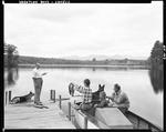 Father And Two Sons Returning From Fishing At A Lake In Lovell by George French