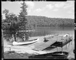 Two Men On Shore Fishing Near A Dock On Stanley Pond In Hiram by George French