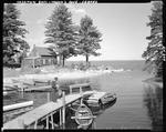 Man On Dock Near A Camp, He Is Getting Ready To Go Fishing At Sebago by George French