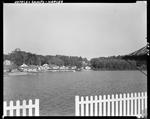 Cabins Along Lake Shore In Naples by George French