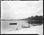 Boy And Girl Shoveling Off A Canoe While Younger Girl Builds A Sand Castle At Little Sebago by George French