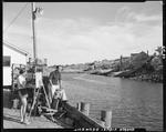 Artist Standing On Wharf Painting Harbor Scene In Ogunquit by George French