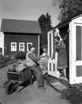 Man With A Wheelbarrow Full Of Vegetables In Northeast Harbor Making A Sales Pitch To A Lady (Phillip And Sister Annie Maclean) by George French