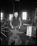 A Blacksmith In Jonesport Working A Piece Of Hot Metal On An Anvil by George French