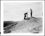 Couple On A Small Hill Overlooking Mountains by George French