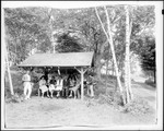 A Group Of People Eating A Picnic Lunch At A Roadside Picnic Area by George French
