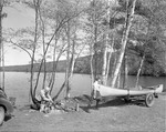 Two Men Setting Up Camp By A Lake by George French