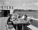 Family Eating Steamed Lobsters At A Lobster Shack In Pemaquid At Gilbert's by George French