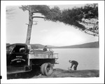 Fish And Game Truck Near A Lake, Workers Preparing To Stock Twitchell Pond by George French
