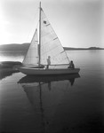 Couple In A Small Sailboat At Rangeley by George French