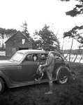 Duck Hunter Talking With Woman Sitting In A Car At Brown's Point by George French