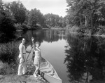 A Couple Getting Into A Canoe by George French