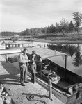 Couple Getting Ready To Go Fishing At Moosehead Lake by George French