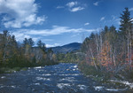 Fall Colors Along A Stream, Mountains Afar by George French