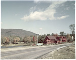 A Red House And Barn In Center Harbor, New Hampshire by George French