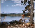 White Lake In New Hampshire, Distant Mountains And Fall Foliage by George French