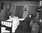 Elderly Man Lying In Bed With Two Women In The Room by George French