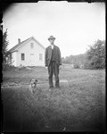 A Man And His Dog Standing Outside His Home by George French
