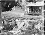 Camp Scene With Children Playing On A Foot Bridge Over A Stream by George French