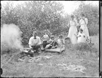 Family Cooking A Picnic Lunch Over A Campfire by George French
