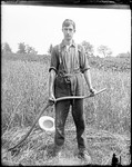 Young Man With A Scythe Standing In A Field by George French