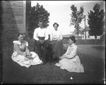 Family Group With Dog Seated On Lawn Outside Of A House by George French