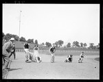 Young Men Running A Sack Race At A Track Meet by George French